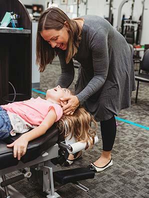 Chiropractor Manhattan IL Dr. Justine Johnson Adjusting