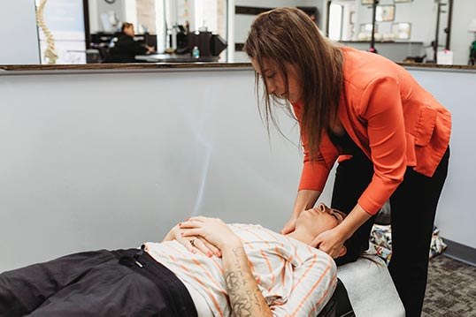Chiropractor Manhattan IL Dr. Laura Mayerson Adjusting Neck